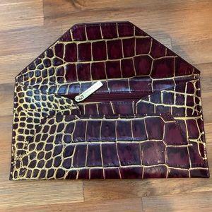 BCBG maroon snake skin envelope clutch/wallet